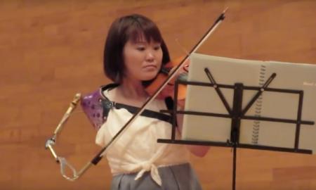 violinista, prótesis, Japón, viral, redes sociales