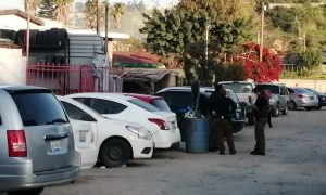taller mecánico, arma de fuego, lesionados, policía municipal