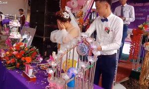 Novios, boda, pareja, fiesta, champagne, corcho, pega, cara, novia, llora, video, viral